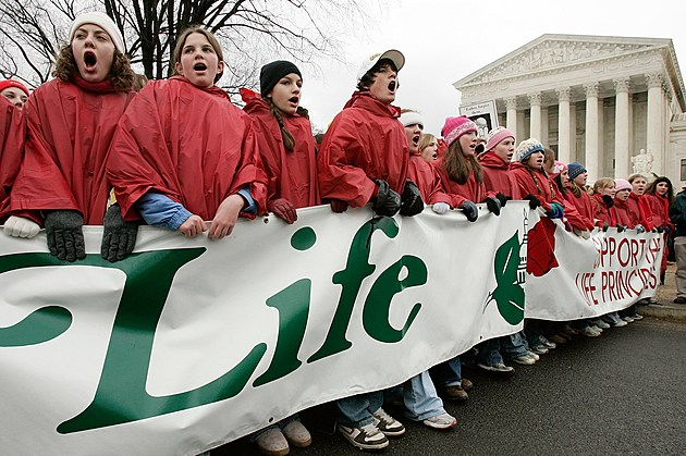 Pro-Life And Pro-Choice Activisits Mark The 33rd Anniversary Of Roe v. Wade